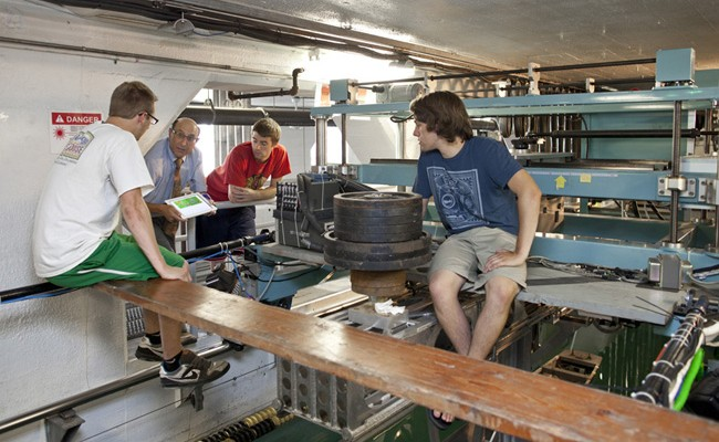 Fred Stern and students at work in the tow tank area.