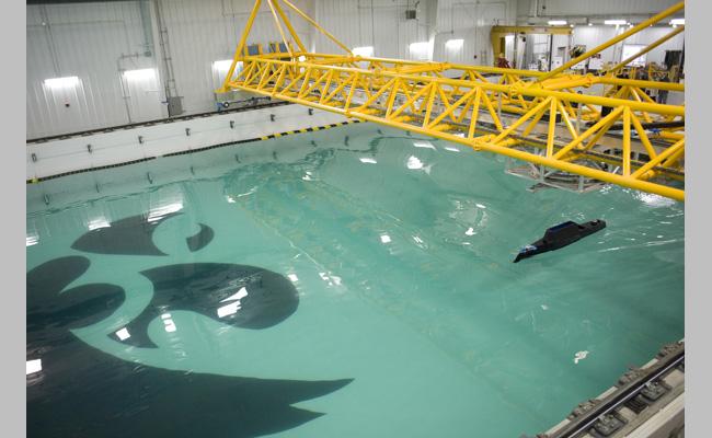 Model ship in IIHR's new wave basin.